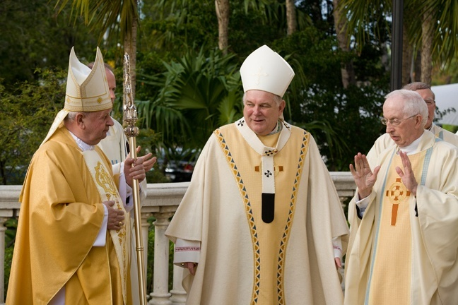Cardinal Stanislaw Dziwisz chats with Archbishop Thomas Wenski and Msgr. John Vaughan, pastor of St. Patrick Church, Miami Beach, before celebrating Mass there Feb. 4.