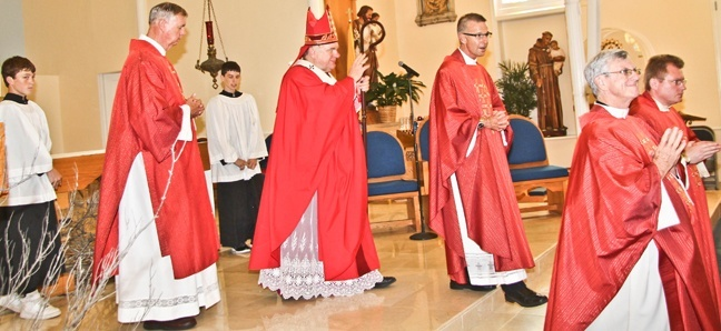 Archbishop Thomas Wenski processes out of the minor basilica of St. Mary Star of the Sea after celebrating the annual Red Mass for those in the legal profession in Monroe County. Accompanying him, from left, are: Deacon Peter Batty and Father John Baker, pastor, of St. Mary Star of the Sea in Key West; Father Gerald Morris, pastor of San Pablo in Marathon; and Father  Henryk J. Pawelec, administrator of San Pedro in Tavernier.