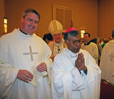 Oblate Missionary Father Andrew Small, left, national director of the Pontifical Mission Societies in the U.S., and Bishop Bejoy D'Cruze, OMI, of Sylhet, Bangladesh, precede Archbishop Thomas Wenski as they process out of Mass.