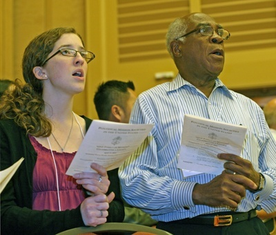 Rachel Barron and Dr. Rodrigue Mortel of the Archdiocese of Baltimore sing during the Mass.