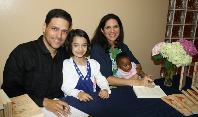 Carmen Santamaria with her husband Alejandro, and their daughters Monica, 6, and Victoria, 8 months.
