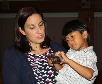 Angelique Ruhi-Lopez holds her son, Emmanuel, 5, at the end of the Mass.