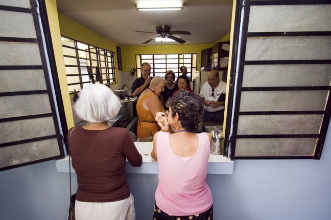 Members of the Cuban Association of the Order of Malta view the kitchen of the feeding program for the elderly operated by Sacred Heart Parish in the Los Pinos section of Havana during a visit to the island in February 2011.