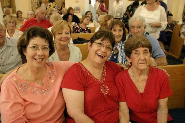 Joyce Griffin, left, sat in her pew at 9:30 a.m. to make sure she held the space for her sister, Carlene Wiseman, center, and their mother, Mary Griffin, 90. All three, and other members of their families, received all their sacraments at St. Mary Star of the Sea Church, where they have been parishioners for decades. Behind them are other longtime parishioners who also received all their sacraments at the new basilica: from left, Gloria Balbontin, 72, Anita Woodruff, 81, and Joe L. Perez, 83.