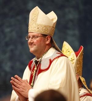 Bishop Gregory Parkes prepares to give his