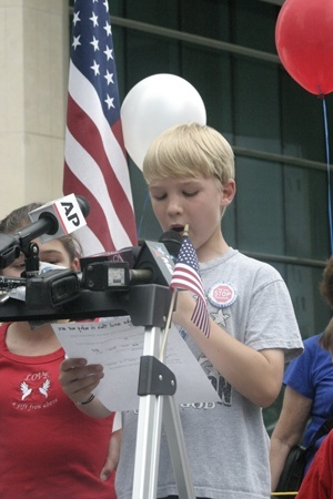 Luke Getchell, who just finished the fourth grade at St. Theresa School in Coral Gables, reads the First Amendment to the U.S. constitution at the start of the Miami rally.