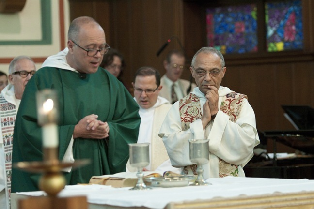 Dominican Father Jorge Presmanes prays the Eucharistic Prayer surrounded by his superior, Father Bruno Cadoré, and other Dominican priests from South Florida.