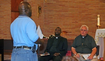A parishioner expresses his joys, concerns and dreams for the Church in South Florida to Oblate Missionary Father John Cox, right, pastor of Holy Redeemer Parish in Liberty City, and Father Chanel Jeanty, archdiocesan chancellor for canonical affairs and pastor of St. Philip Neri in Miami Gardens.