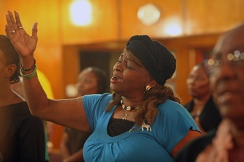 Rosetta Rolle Hylton sings at the end of the Synod listening session.