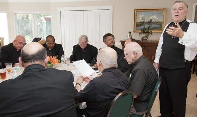 Archbishop Thomas Wenski relays Synod information to the pastors as they finish their lunch.