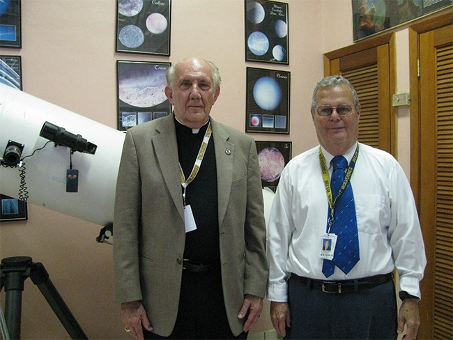 Jesuit Father Pedro Cartaya and meteorologist Pedro Añon pose for a photo in the observatory of Belen Jesuit Prep.