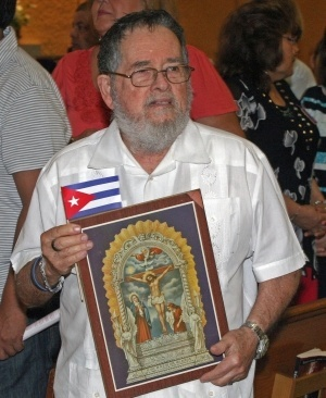 Jose Antonio Areces, a Cuban, holds an image of Our Lord of Miracles. A Peruvian friend gave him the image and said Jesus Christ is the same for all.