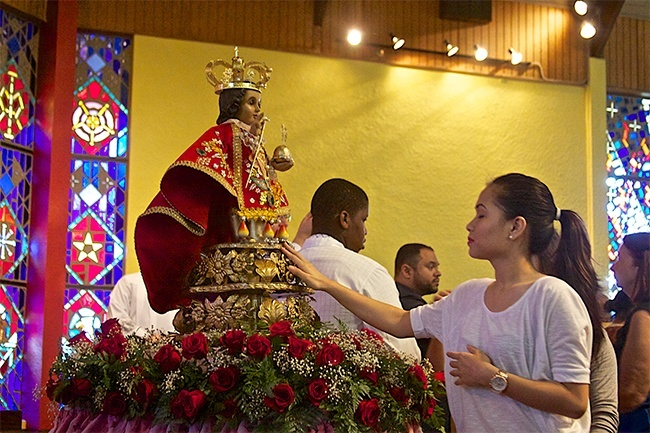 Rossamina Tumulak, a parishioner at St Bernard Church, pays her respects to the image of