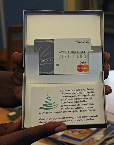 The 0 gift card that each of 55 families received.