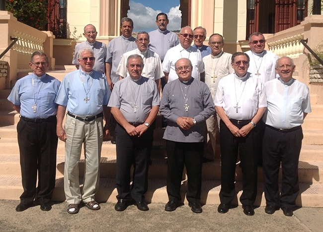 Pictured: The bishops of Cuba's 11 dioceses, including Havana's Cardinal Jaime Ortega, front row, third from right. Cuba has eight bishops, three archbishops (including the cardinal) and two auxiliary bishops, both in Havana. To his right is Archbishop Bruno Musaro, papal nuncio to Cuba.