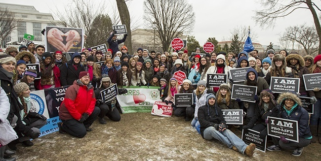 Some of the more than 130 high school students from 11 Catholic schools in the Archdiocese of Miami who went to Washington, D.C., pose for a photo after participating in this year's March for Life. This is the 40th March for Life – which protests abortion – and it is also the 40th anniversary of the U.S. Supreme Court decision legalizing abortion nationwide.