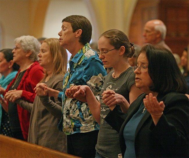 Respect life ministers hold hands and pray the Our Father. From left: Joan Smith of Holy Rosary-St. Richard Parish, Kathy Weissinger, Mary Salter and Kristen Weissinger of St. John Neumann, and Maria Wadsworth of St. Louis.