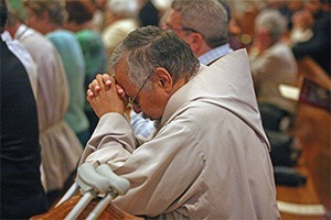 Brother Jay Rivera, founder and superior of the Franciscan Brothers of Life and archdiocesan coordinator of the Respect Life Office's Project Joseph, prays during the Mass.