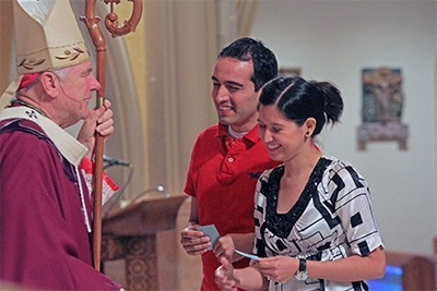 Archbishop Wenski commissions Respect Life lay ministers Camilo & Ana Rodriguez, who are expecting a baby in September.