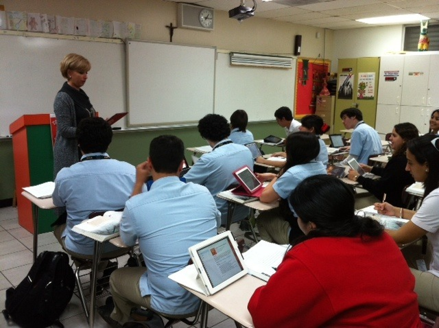 Msgr. Edward Pace High School's principal, Ana Garcia, engages a Spanish IV Honors/Dual Enrollment class in a hands-on discussion utilizing iPads