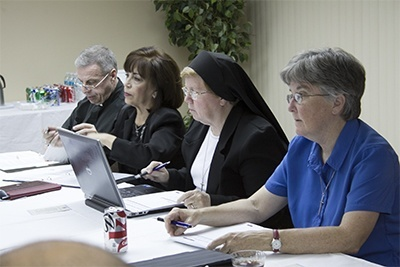 Members of the Synod task force on an archdiocesan pastoral council at their most recent meeting, from left: Msgr. Pablo Navarro, Vilma Angulo, Sister Elizabeth Worley and Sister Kathleen Carr, both Sisters of St. Joseph of St. Augustine.
