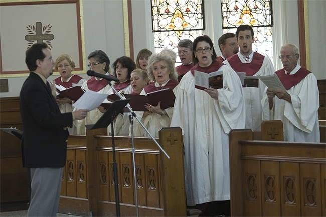 The choir from St. John Neumann Parish, directed by attorney Gregory Sendler, sings at the Red Mass.