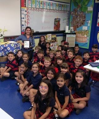 97.3 FM the Coast selected Blessed Trinity kindergarten teacher Melinda Usallan as April's Teacher of the Month; a school parent nominated her. Along with a plaque, she received a  Office Depot gift card and a family four-pack to the Museum of Science & Imax in Fort Lauderdale.