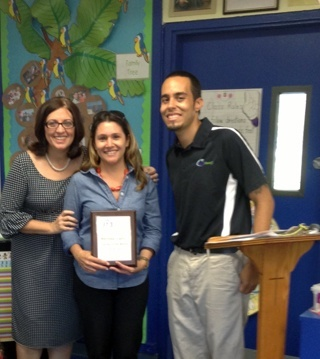 Blessed Trinity principal Maria Teresa Perez, 97.3 FM the Coast Teacher of the Month Melinda Usallan and a representative from the radio station pose after presenting Usallan with her award.