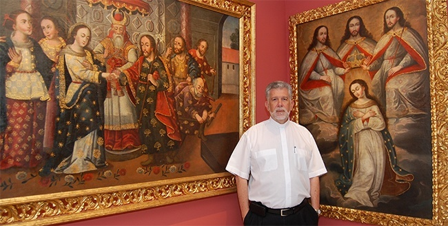 Father Jose Luis Menendez shows two colonial artworks at La Merced church-museum.