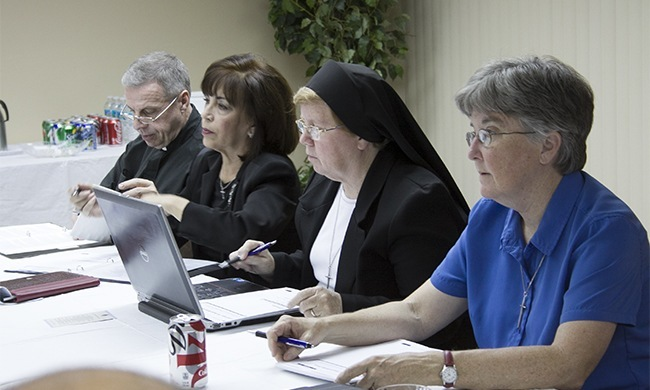 Members of the Synod task force on an archdiocesan pastoral council at one of their meetings, from left: Msgr. Pablo Navarro, Vilma Angulo, Sister Elizabeth Worley and Sister Kathleen Carr, both Sisters of St. Joseph of St. Augustine.
