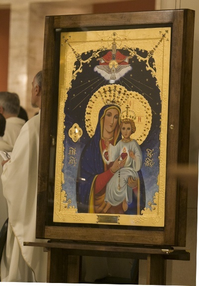 The icon of the two hearts of Jesus and Mary sits on the altar of St. Mary Cathedral during the Mass of consecration.