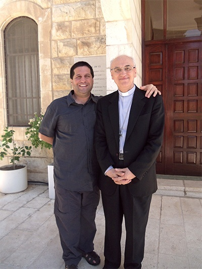 David Masters poses with the papal nuncio to Israel, Archbishop Giuseppe Lazzarotto, one of the people the Catholic educators met with during their stay in the Holy Land.