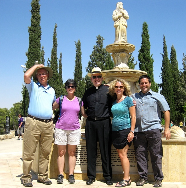 At the Shepherds' Field near Bethlehem, David Masters, far right, poses with fellow Bearing Witness travelers John Thomas, Donna Tarney, ather Michael Dolan, director of vocations for the Archdiocese of Hartford, Conn., and Robin Siczek.