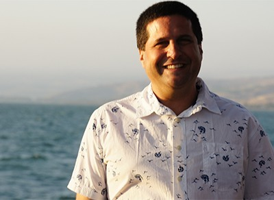 David Masters is pictured here with the Sea of Galilee behind him.