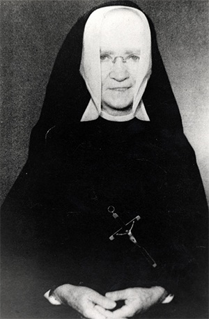 Historical photo of Sister M. Louise Gabriel, of the Sisters of Holy Names of Jesus and Mary, who spearheaded the building of a grotto on the grounds of St. Mary Star of the Sea to protect the island from destructive hurricanes.