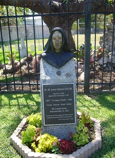 This bust of Sister M. Louise Gabriel, with her prayer that Key West be protected from storms, stands next to the grotto and shrine to Our Lady of Lourdes that she had built on the grounds of St. Mary Star of the Sea Church.