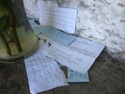 Scraps of paper with prayer requests are left at the grotto to Our Lady of Lourdes which is located on the grounds of the Basilica of St. Mary Star of the Sea in Key West.