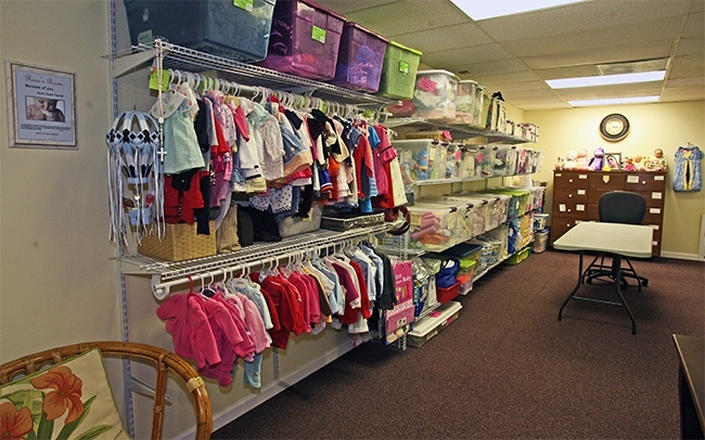 A room at the new Central Broward Pregnancy Help Center is filled with donated baby items that are given to clients who pay with Baby Bucks earned from taking classes at the center.