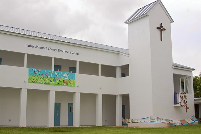 The Father Joseph T. Carney Enrichment Center took several years to complete and now houses the school's Pre-K2 and Pre-K3 classes along with meeting rooms. The cross hanging on the tower was created by the school's art teacher, Natalie Calvo.