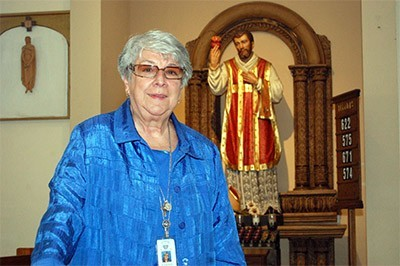 Sister Vivian Gomez wants someday to write a book on St. Philip Neri, her order's founder, whose statue is shown here in the sanctuary at St. Jerome.