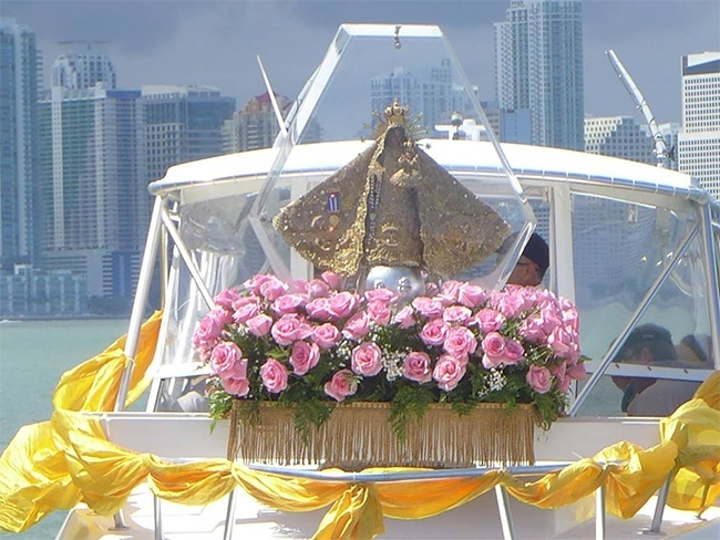 The pilgrim image of Our Lady of Charity is outlined against the Miami sky as she makes her way through Biscayne Bay blessing the city and its residents.