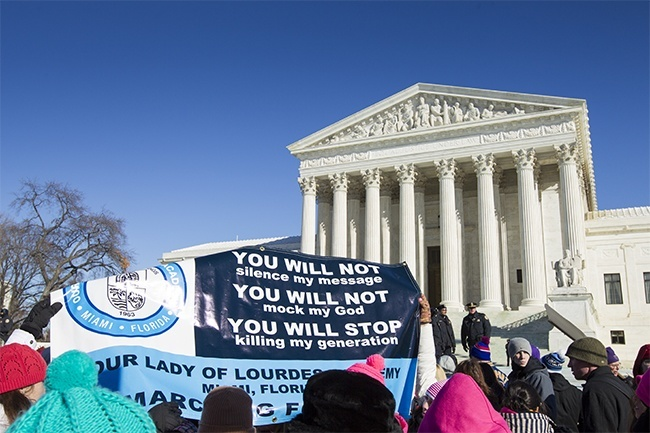 Students from Our Lady of Lourdes Academy in Miami hold up a banner in front of the Supreme Court during the 41 annual March for Life in Washington, D.C.
