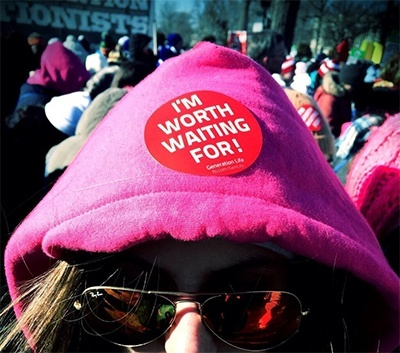 A March for Life participant shares her message with the world via a button on her hoodie.