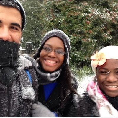 Daniel Diaz, Iboni Richards and Aisha Louis of Archbishop Curley Notre Dame High School enjoy a snow day during the March for Life in Washington, D.C.