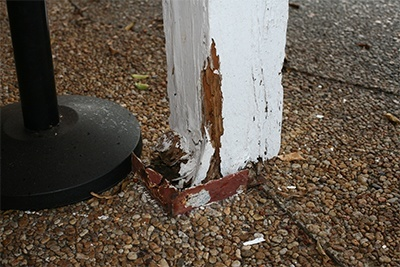 Rotted wood columns hold up the awning above the entrance to St. Maurice Church. The parish cannot afford to make the extensive repairs that would make the building safe once more.