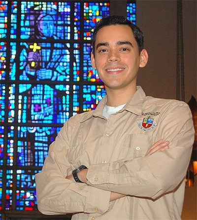 Alvaro Vega poses near a stained glass window at St. Vincent de Paul Seminary where he is studying for the priesthood in the Archdiocese of Miami.