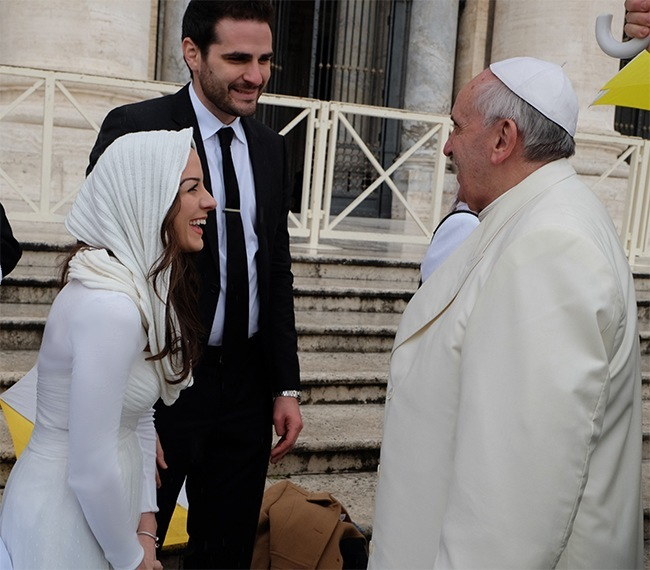Melissa and Ryan Ulloa during their Spanish-language chat with Pope Francis.