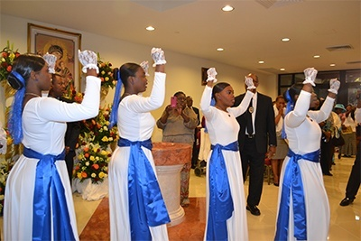 Young parishioners process into church in typically rhythmic Haitian style.
