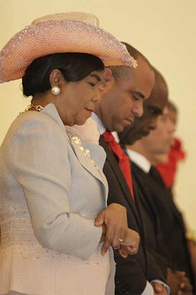 Congresswoman Frederica Wilson and Haitian Prime Minister Laurent Lamothe bow their heads in prayer at the start of the Mass.