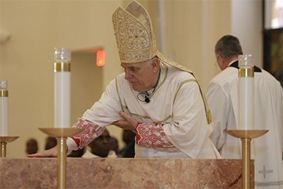 Archbishop Thomas Wenski rubs the oil of chrism on the altar of Notre Dame d'Haiti Church.
